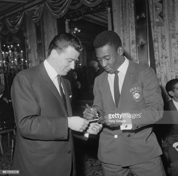Brazilian soccer player Edson Arantes do Nascimento known as Pele signing an autograph for West Ham FC soccer player Johnny Byrne UK 9th May 1963