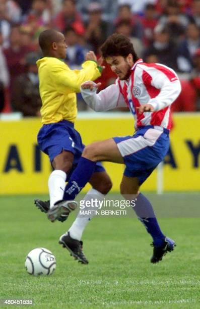Brazilian soccer player Ewerton fights for the ball with Paraguayan Thomas Guzman 15 January 2001 in Ambato Ecuador El jugador Brasilero Ewerton...