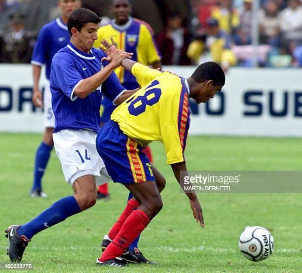 Brazilian soccer player Fernando marks Ecuadoran Juan Godoy 21 January 2001 in Ambato Ecuador El jugador brasileno Fernando marca al ecuatoriano Juan...