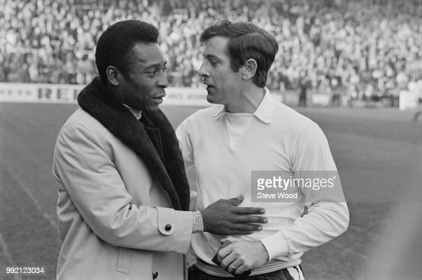 Brazilian soccer player Pele with English soccer player Alan Mullery of Fulham FC London UK 12th March 1973