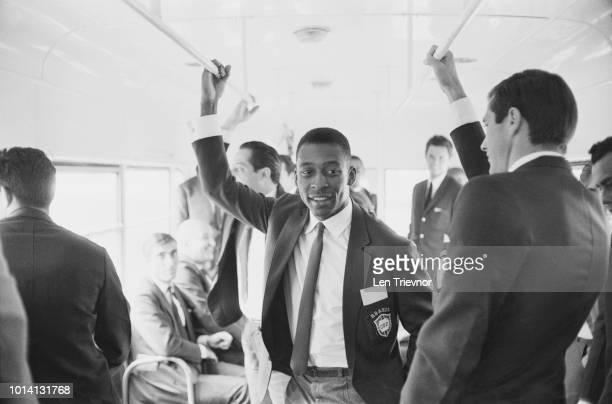 Brazilian soccer player Pele with his teammates of Brazil national football team travelling on a bus upon their arrival in the UK for the 1966 Fifa...