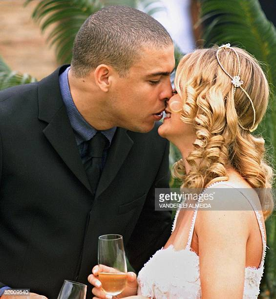 Brazilian soccer player Ronaldo kisses his wife Milene Domingues during their marriage 24 December 1999 in Rio de Janeiro The couple have announced...
