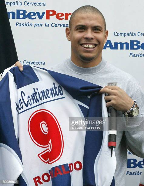 Brazilian soccer player star Ronaldo Nazario shows an Alianza de Lima soccer club shirt during a visit at the club's stadium in Lima Peru 22 June...