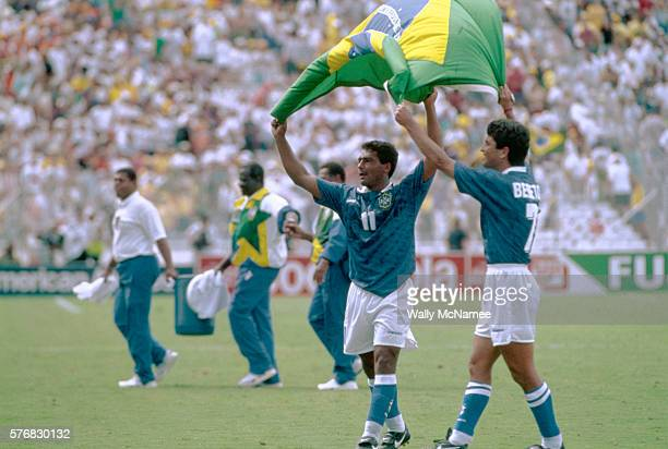Brazilian soccer players wave a flag of their home country after winning a match at the 1994 World Cup