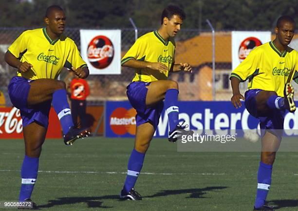 Brazilian soccer players Ze Maria Cesar and Joan Carlos train 27 June 1999 in Foz de Iguazu Brazil Los jugadores del seleccionado de futbol de Brasil...