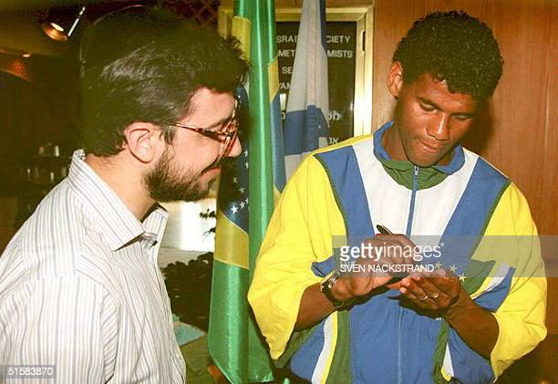 Brazilian soccer star Aldair who plays for AS Roma signs an autograph for a religious Israeli fan 16 May at the Herzeliya hotel Israel where the...