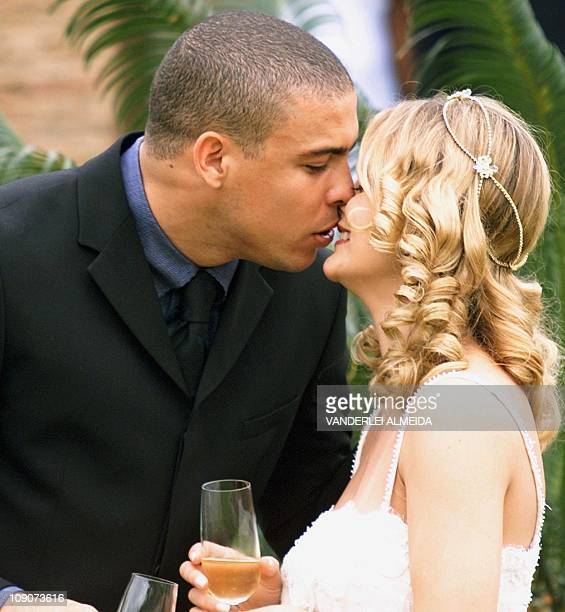 Brazilian soccer star for Inter Milan Ronaldo kisses his wife Milene Domingues after their wedding ceremony at his mother's house in Rio de Janeiro...
