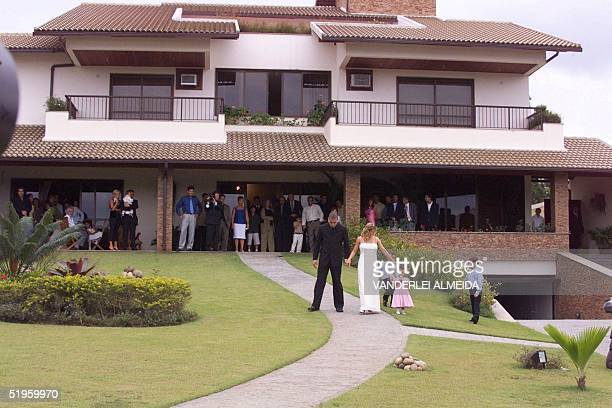 Brazilian soccer star for Inter Milan Ronaldo walks with his wife Milene Domingues after their wedding ceremony at his mother's house in Rio de...