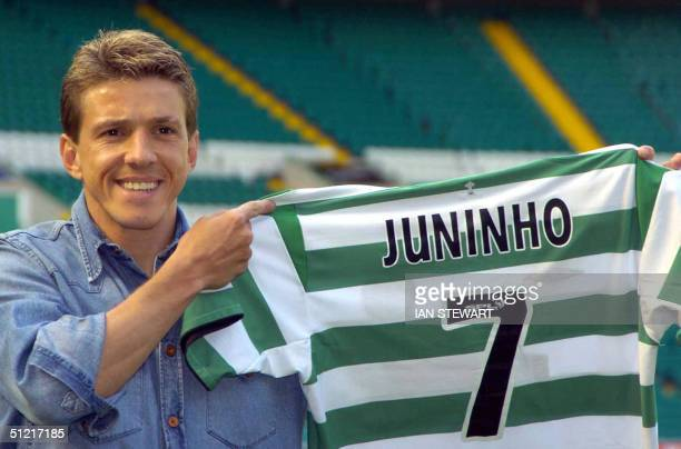 Brazilian soccer star Juninho holds up his jersey after transferring from Middlesbrough to Celtic at a presentation to the press 25 August 2004 in...