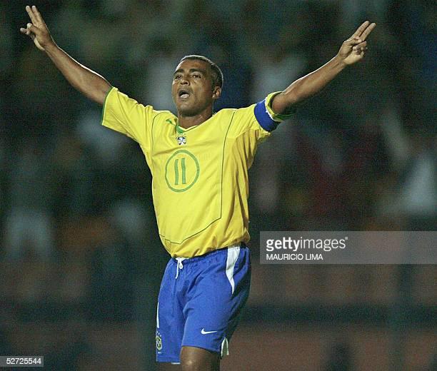 Brazilian soccer star Romario celebrates his goal during a friendly match against Guatemala in his retiring homage 27 April 2005 at Pacaembu stadium...