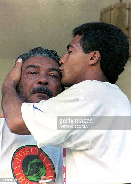 Brazilian soccer star Romario of the FC Barcelona kisses his father Edevair Farias in Rio de Janeiro Brazil 09 May 1994 after being reunited with him...