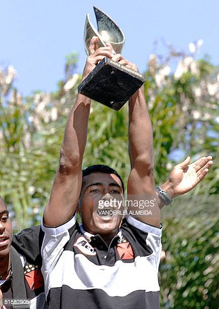 Brazilian soccer star Romario the player of Vasco da Gama shows the Mercosur Cup trophy to his fans during the arrival to Rio de Janeiro Brazil 21...