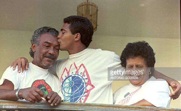 Brazilian soccer star Romario who plays for the Spanish club of Barcelonakisses his father Edevair Farias in Rio de Janeiro Brazil 09 May1994 at his...