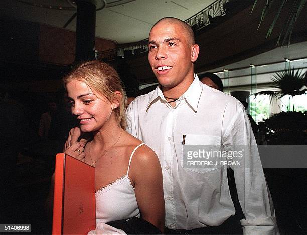 Brazilian soccer star Ronaldo and friend Milene Domingues arrive at their hotel 08 August 1999 in Hong Kong. The Inter Milan player is promoting a...