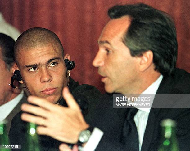 Brazilian soccer star Ronaldo listens to Massimo Moretti drector of the Inter de Milan soccer club 22 July during a conference marking the launching...