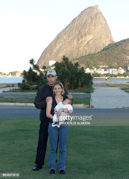 Brazilian soccer star Ronaldo Nazario poses with his wife Milena Rodrigues Nazario and son Ronald before a press conference in Rio de Janeiro 29 May...