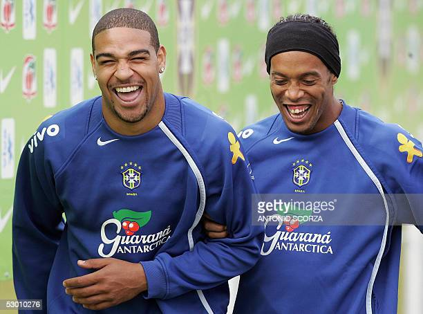Brazilian soccer strickers Adriano Ribeiro of Internazionale and Ronaldinho Gaucho of Barcelona laugh 02 June 2005 during a training session in...
