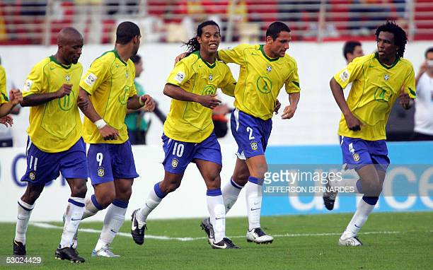 Brazilian soccer striker Ronaldinho Gaucho celebrates a goal against Paraguay with his teammates 05 June 2005 during their Germany 2006 FIFA World...