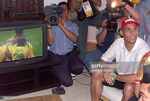 Brazilian soccer striker Ronaldo looks at a journalist 17 June during the replay of his jubilation from yesterday's match against Morocco in a press...
