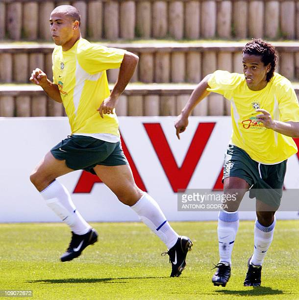 Brazilian soccer striker Ronaldo Nazario runs beside his teammate Ronaldinho Gaucho during the morning training session 27 May 2002 at the Mipo...