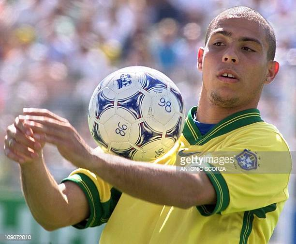 Brazilian soccer striker Ronaldo plays with the ball, 19 June, during the practice at Trois Sapin stadiun in Ozoir la Ferriere, outside of Paris....