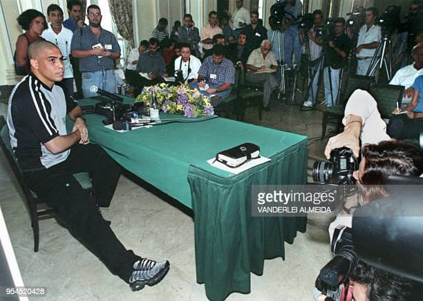 Brazilian soccer superstar Ronaldo addresses a press conference after his arrival at the Tom Jobim Airport in Rio de Janeiro 15 December 1999 The...