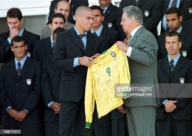 Brazilian soccer superstar Ronaldo presents a jersey bearing his number and autographed by all the members of the Brazilian national soccer selection...