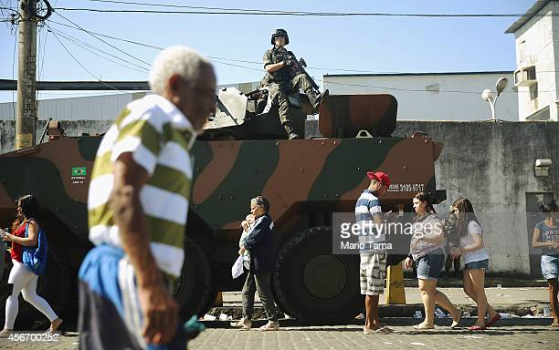 Brazilian soldier keeps watch in the Complexo da Mare favela or community on the day of national elections on October 5 2014 in Rio de Janeiro Brazil...