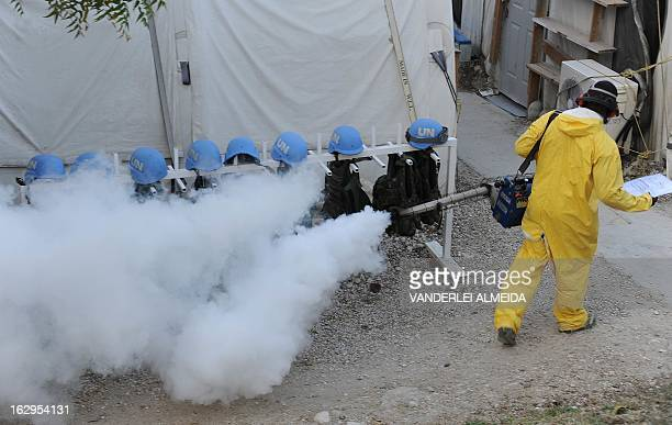 A Brazilian soldier with the MINUSTAH force fumigates in a military base in PortauPrince on March 1 2013 Brazil began the process of reducing its...