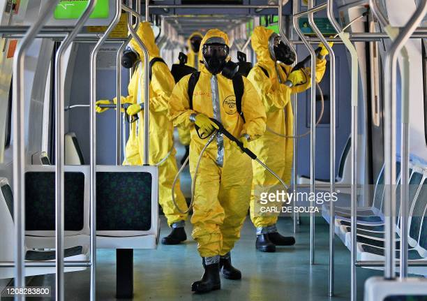 TOPSHOT Brazilian soldiers disinfect a train carriage in Central Station as a measure against the spread of the coronavirus COVID19 pandemic in Rio...