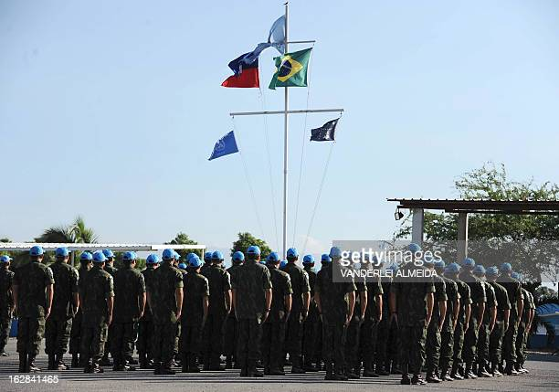 Brazilian soldiers fall in during a ceremony for the replacement of troops of the MINUSTAH mission at the military base in Port-au-Prince on February...