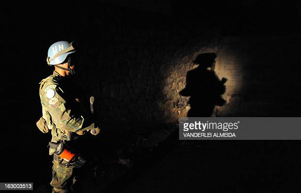 Brazilian soldiers of the MINUSTAH force patrol along a shantytown in Port-au-Prince on March 3, 2013. Brazil began the process of reducing its...