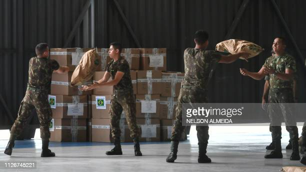 Brazilian soldiers organize sacks of powdered milk that are part of the humanitarian aid for Venezuela at Ala 7 air base in Boa Vista Roraima state...