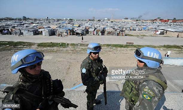 Brazilian soldiers patrol a camp for survivors of the January 2010 quake in Haiti which killed 250,000 people, on February 28, 2013 in...