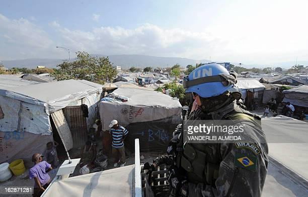 Brazilian soldiers patrol a camp of survivors of the January 2010 quake in Haiti which killed 250,000 people, on February 28, 2013 in Port-au-Prince....