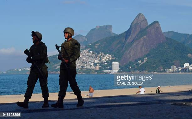 TOPSHOT Brazilian soldiers patrol on Ipanema beach in Rio de Janeiro on April 14 2018 Military operations against drug gangs have increased in...