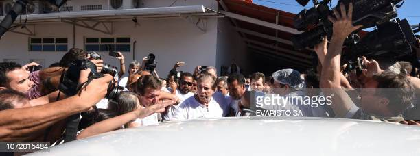 Brazilian 'spiritual healer' Joao Teixeira de Faria known as 'Joao de Deus' is escorted by supporters upon arrival at his 'healing center' Casa de...