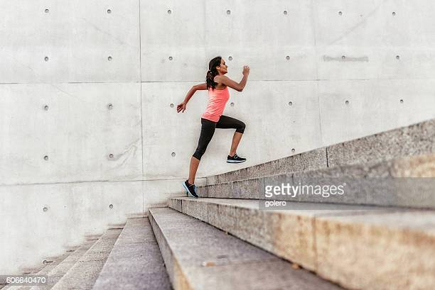 brazilian sports woman running up outdoor stairway in berlin