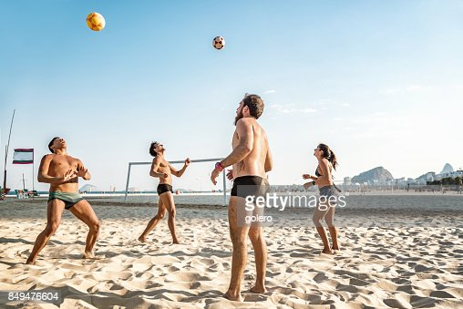 brazilian sportspeople playing footvolley at beach in Rio de Janeiro