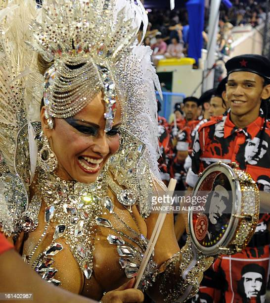 Brazilian star cinema Viviane Araujo of Academico do Salgueiro samba school performs during the first night of Carnival parade at the Sambadrome in...
