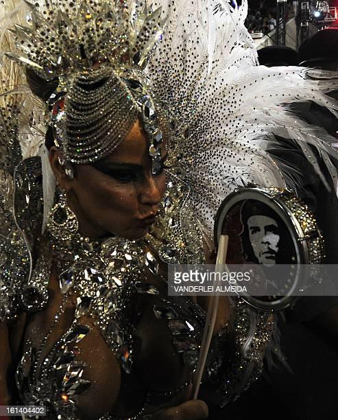 Brazilian star cinema Viviane Araujo of Academico do Salgueiro samba school performs during the first night of Carnival parade at the Sambadrome in...