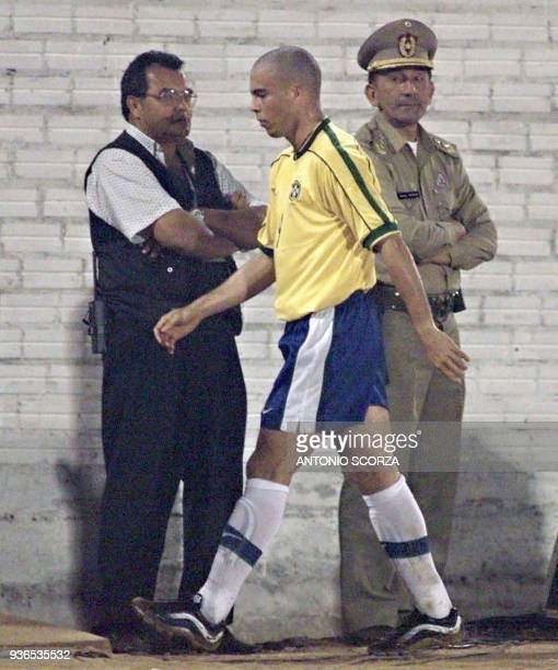 Brazilian star Ronaldo leaves the field 14 July after being replaced by Ronaldinho in their semifinal game against Mexico in Ciudad del Este Paraguay...