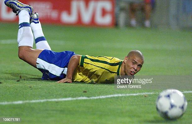 Brazilian star Ronaldo looks at the ball after falling during the 1998 Soccer World Cup semifinal match Brazil vs The Netherlands 07 July at the...
