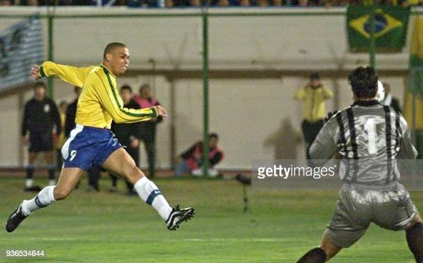 Brazilian star Ronaldo scores his team's third goal 18 July in Asuncion Brazil defeated Uruguay 30 for the championship of the Copa America soccer...