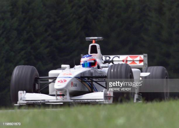 Brazilian StewartFord driver Rubens Barrichello steers his car on the racetrack during the first free practice session in Spielberg 23 July two days...