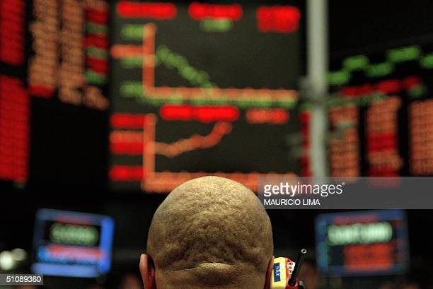Brazilian stock trader negociates to buy and sell inside the future dollar pit at the Futures and Commodities Market in Sao Paulo Brazil 21 July 2004...