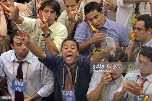 Brazilian stock traders negociate the buying and selling of the future dollar during the afternoon trading session at the Futures and Commodities...
