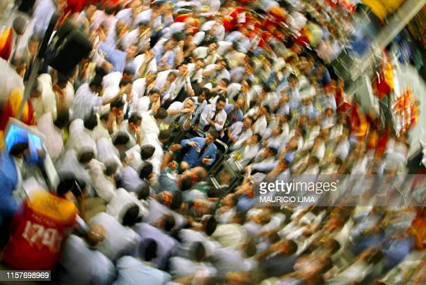 Brazilian stock traders negociate to buy and sell inside the future dollar pit at the Futures and Commodities Market in Sao Paulo Brazil 21 July 2004...