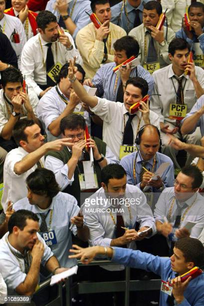 Brazilian stock traders negociate to buy and sell inside the future interest rate pit at the Futures and Commodities Market in Sao Paulo Brazil 21...