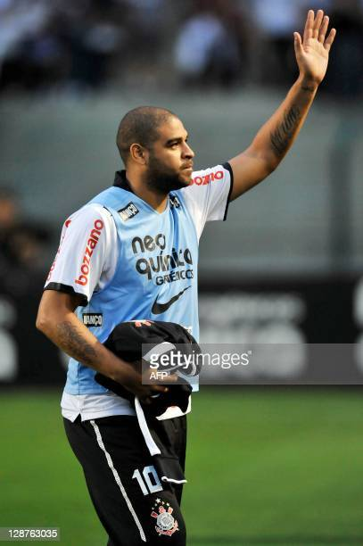 Brazilian striker Adriano of Corinthians, waves to supporters before their Brazilian Championship football match against Atletico Goianiense, at...